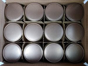 Candle lids in box